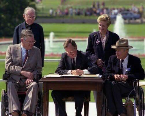 President Bush signing the Americans with Disabilities Act into law
